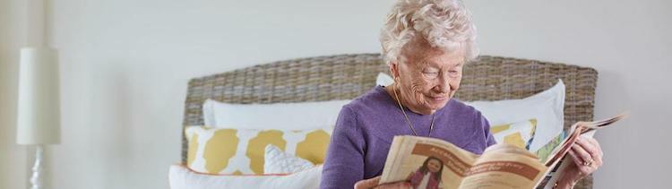 senior woman reading news