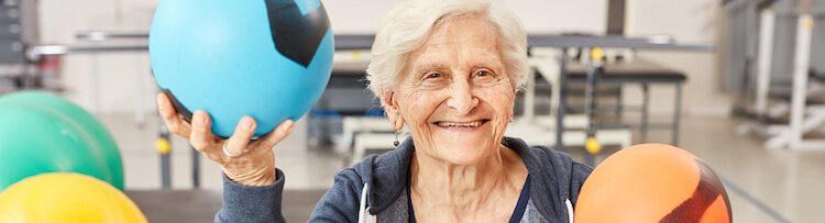 senior woman working out with balls